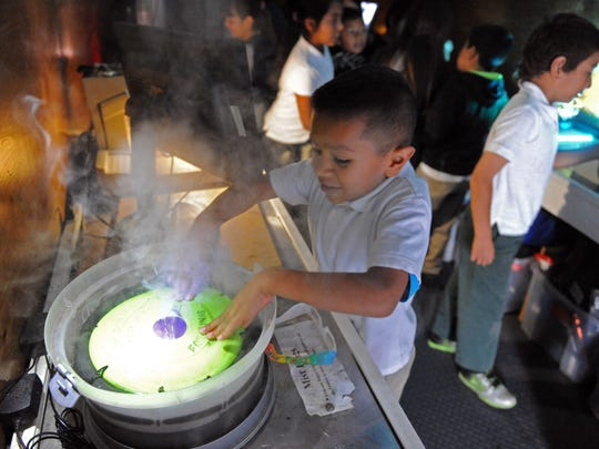 An Alisal Community School student creates mist rings inside the Physics Bus during a recent visit.