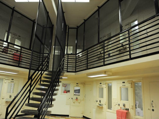 New protective fencing wraps an upper stairway in the women's section of the Monterey County Jail in Salinas.