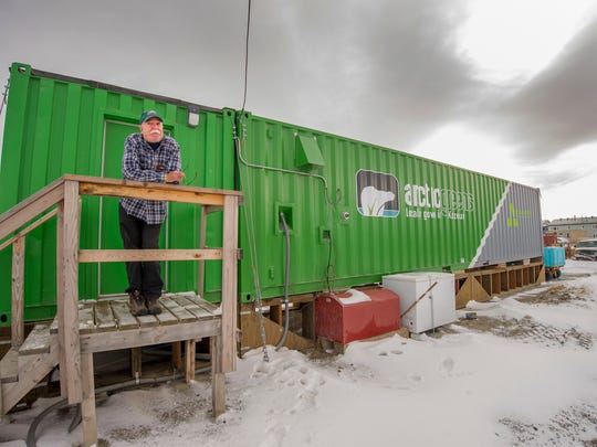 Employee Joe Carr stands outside a new indoor hydroponics farm owned by a local Alaska Native corporation in Kotzebue, Alaska.