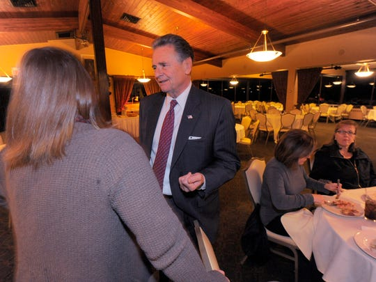 Public Works Commissioner Anthony V. Marrocco, a Democrat, speaks with a resident, Nov. 8, 2016, while waiting for election results at the Burning Tree Golf Course in Macomb Township on election night.