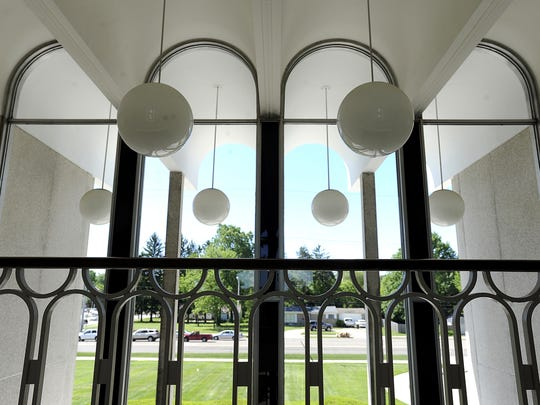 Large glass globes hang throughout the interior of the Michigan State Medical Society building. The building is one of 16 houses and businesses featured on a walking/biking tour as excellent examples of mid-century modern architecture in East Lansing. Greg DeRuiter/Lansing State Journal Large glass globes hang through out the interior of the Michigan State Medical Society Building in East Lansing. Photo taken 6/3/2013 by Greg DeRuiter   LSJ