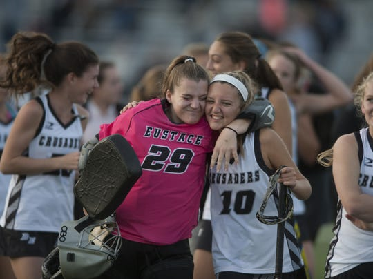 Bishop Eustace Brenna Miller, left, and Kerry Monaghan embraced after winning over Paul VI in the Non-Public Sectionals finals at Bishop Eustace.