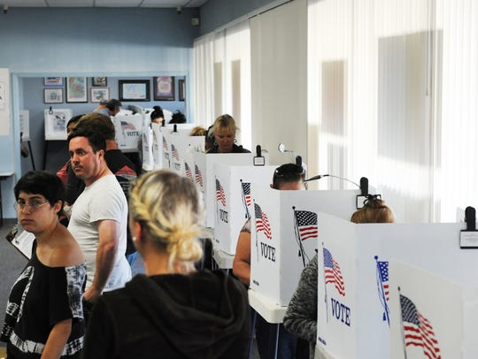 Voters at the polls in Monterey County during a recent election.