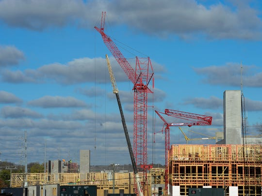 Cranes and workers strive to meet their schedule of