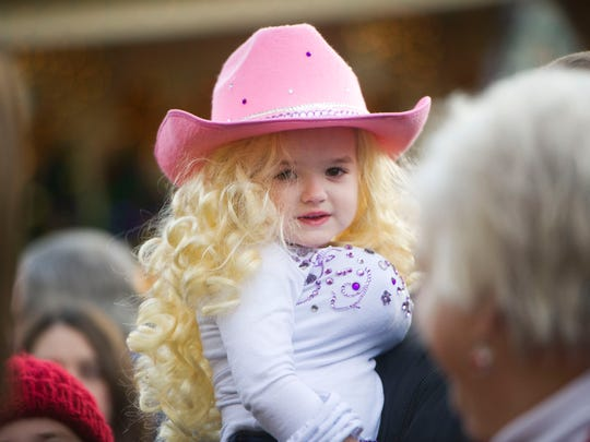 Sadie Swiney, 3, of Sidney, Ky., waits for the red