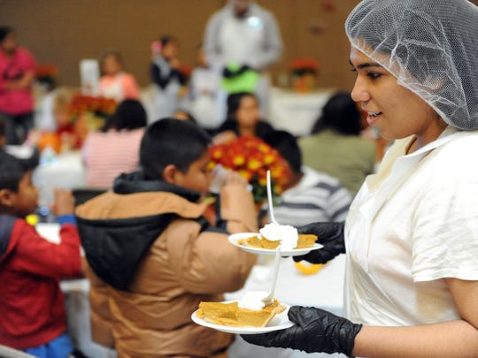 Service with a smile at the Castroville Community Feast on Thanksgiving Day.