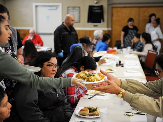 In this file photo, a meal finds an eager taker on Thanksgiving 2016 at American Legion Post 31 in Salinas.