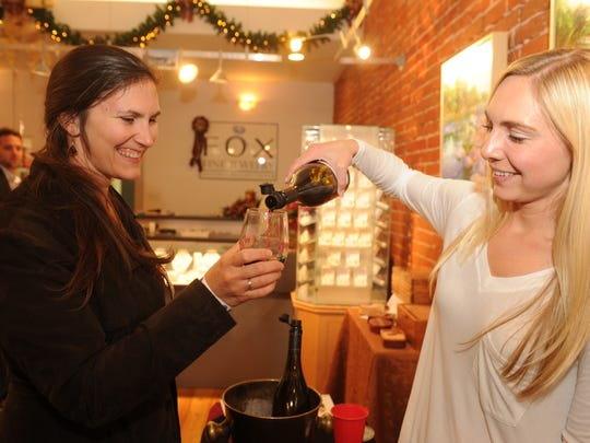 Participants in Ventura's Winter Wine Walk two years ago enjoy wine, refreshments and shopping downtown.