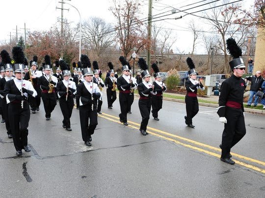 Milford High School Marching Band entertains at the annual Christmas parade.