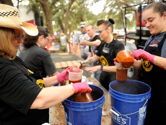 Volunteers from the Taylor County Sheriff's Officer's Association and the Dyess We Care Team package up the 580 gallons of chili made to be sold at the 2016 Chili Super Bowl.