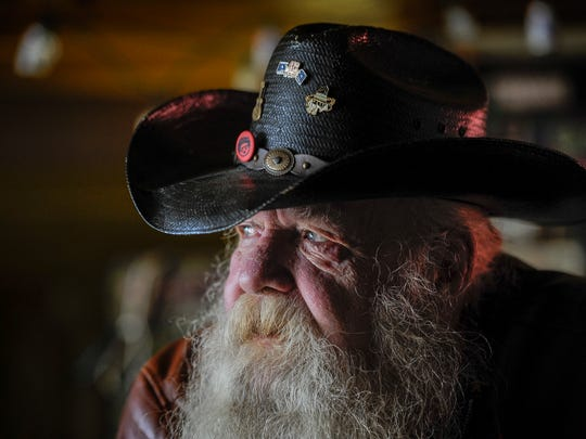 Denzel Irwin, aka Santa, stands behind the bar at Santa's Pub on Thursday Dec.15, 2016 in Nashville, Tenn. Irwin opened Santa's Pub in 2011,  because he needed to do something after retiring.