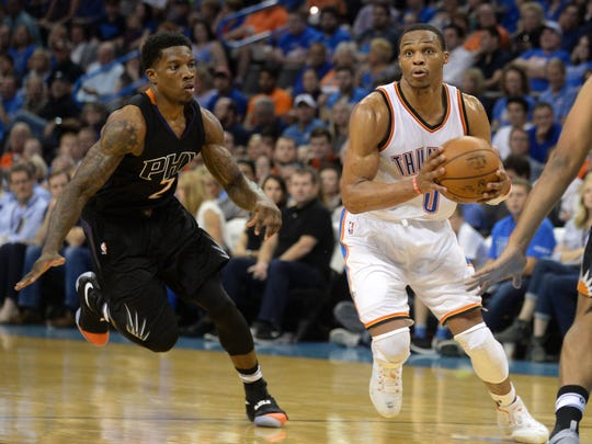 Oklahoma City Thunder guard Russell Westbrook (0) drives to the basket in front of Phoenix Suns guard Eric Bledsoe (2) during the second quarter at Chesapeake Energy Arena on Oct. 28.