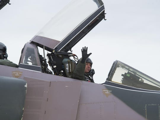 Lt. Col. Ronald King, 82 Aerial Target Squadron Det 1, waves goodbye before taking off during the QF-4 Phinal Phlight event Dec. 21 at Holloman Air Force Base. Hundreds of people were in attendance to commemorate the aircraft's retirement, marking the end of the aircraft's 53 years of service to the Air Force.