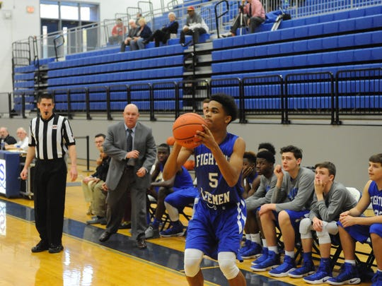 Lee's Manny Johnson shoots a 3-pointer during Lee High's game with Sherando Wednesday afternoon at Spotswood.