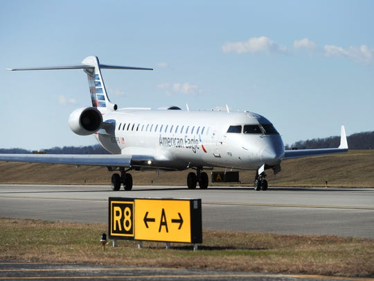 An American Eagle regional jet moves on taxiway Alpha