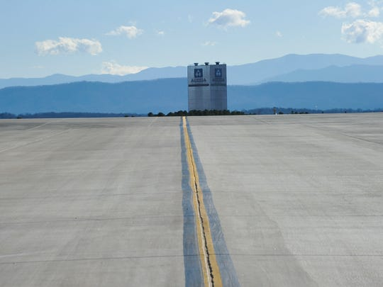 The ALCOA, now Arconic Inc.,  plant tower is pictured with a portion of the Metropolitan Knoxville Airport Authority's runway and taxiway construction project Thursday, Dec. 29, 2016, at McGhee Tyson Airport.