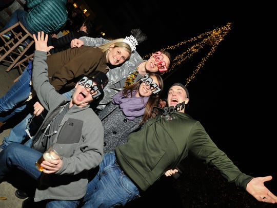 Scenes from the New Year's Eve keg drop at the Thirsty Monk at Biltmore Park, in Asheville on December 31, 2016. MIKE RICE / Citizen-Times