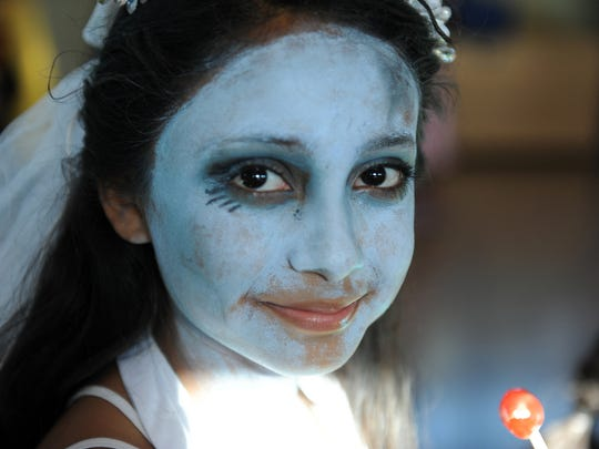 Ashley Corral, 11, is the Corpse Bride on Monday. Children and adults alike made the afternoon of Halloween a festive one at the César Chávez Library in Salinas.