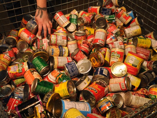 Volunteers sort cans at the Food Bank of West Central Texas Friday, Jan. 6, 2017.