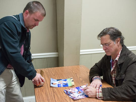 Jeremy Young, of Henderson, Tenn., left, gets an autograph from Don Mattingly during the Night of Memories at the Vanderburgh 4-H Center in Evansville. Saturday, Jan. 7, 2017.