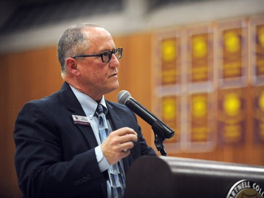Willard Lewallen, president of Hartnell College, addresses a community meeting at Hartnell on Monday evening to introduce new Salinas Police Chief Adele FresŽé.