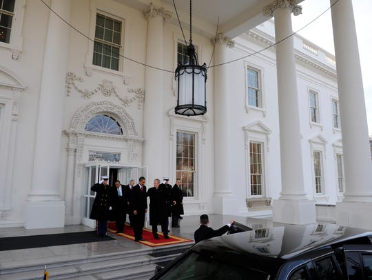 Bush and Obama depart the White House on Jan. 20, 2009.