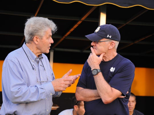 Joe Echelle, Class of 1958 at St. Peter's, talks with Notre Dame men's soccer coach Bobby Clark while back on campus last September to receive the  Harvey G. Foster Award for distinguished service.