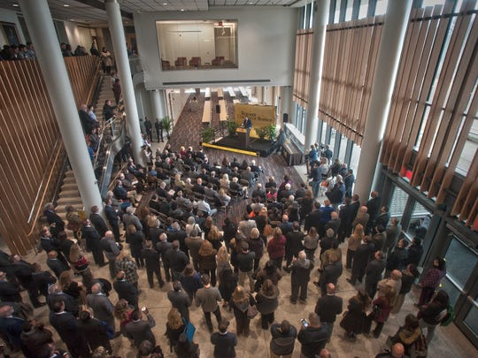 Rowan University President Dr. Ali Houshmand speaks to a large crowd at the new business building dedication ceremony.