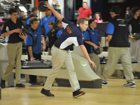 Jacob Lear takes aim at the pins during his team's