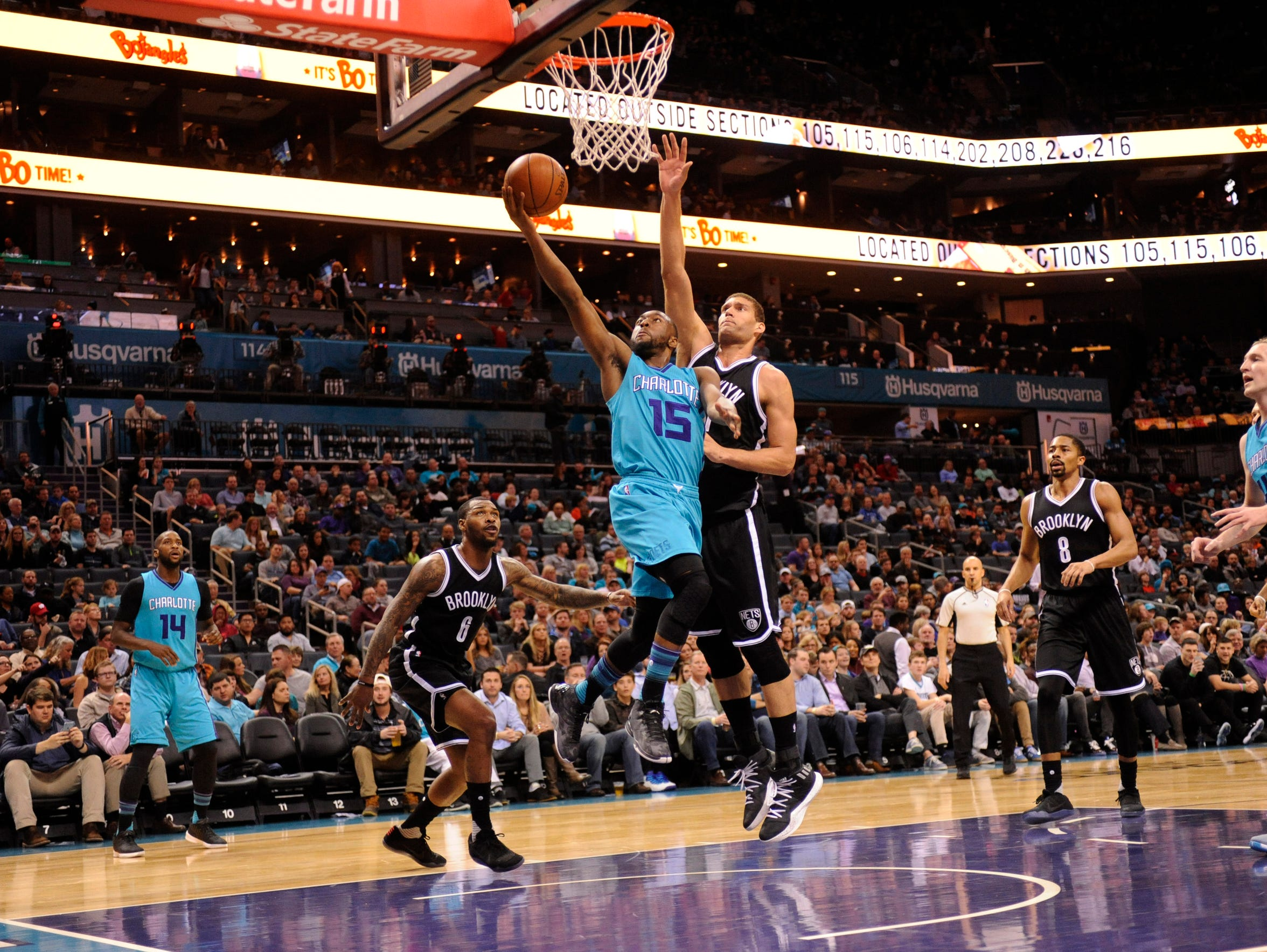 Charlotte Hornets guard Kemba Walker (15) drives to