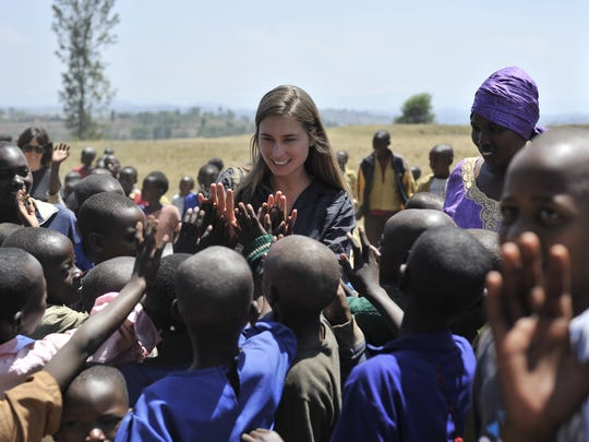 Lauren Bush Lauren visits with youngsters at a food site in Rwanda.