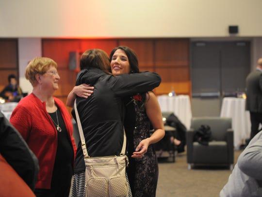 Domestic abuse survivor Jenna Neth embraces in a hug
