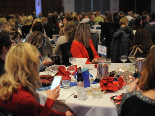 Attendees of The Compass Center fundraiser event donate