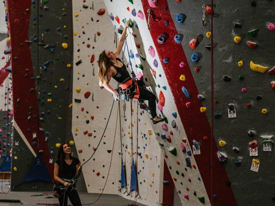 Adventure Rock, 2220 N. Commerce St., provides climbs