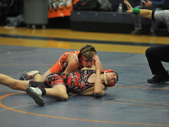 Bucyrus' Garrett Jackson tries to escape the hold from