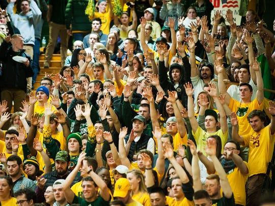 Vermont fans cheer for the team during the men's basketball