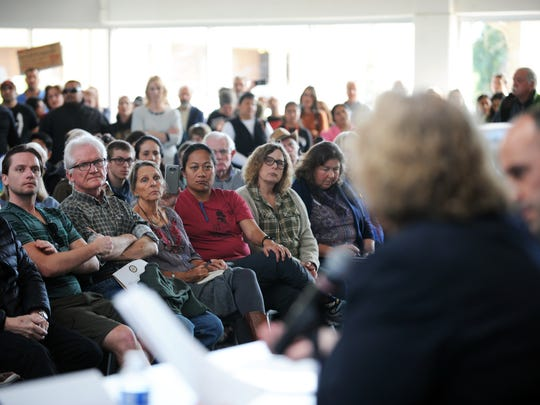 Members of the audience listen intently at an immigration town hall on Sunday at Hartnell College in Salinas.