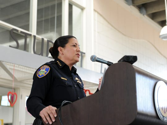 Salinas Police Chief Adele FresŽé addresses a crowded immigration town hall on Sunday at Hartnell College in Salinas.