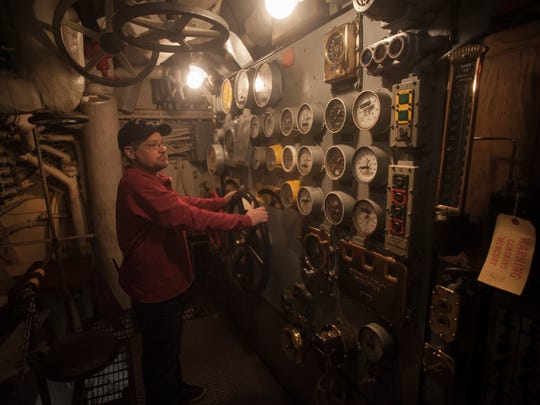 Battleship New Jersey Museum Staff, Ken Newman stands inside the ship engine control room, an area soon to be open to the public