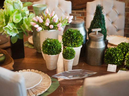Greenery makes a pleasing table setting at Modern Vintage Home in Cherry Hill.