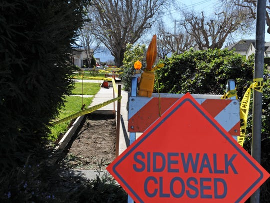 Photographed from the corner of Riker and Clay Streets, sidewalks in the city of Salinas being repaired in an improvement program.