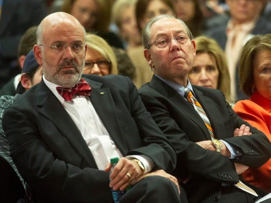 UT President Joe DiPietro, left, and Chancellor Jimmy Cheek look on as new head football coach Butch Jones is introduced on Friday, Dec. 7, 2012, at the University of Tennessee.