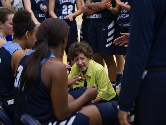 Jackson Academy coach Jan Sojourner encourages her players from the sideline during Saturday's MAIS Overall championship game held at A.E. Wood Coliseum in Clinton.