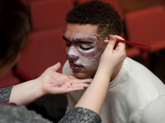 "Sam Fulton, who is portraying the Wolf in Mater Dei's production of ""Into the Woods,"" gets ready for a rehearsal."