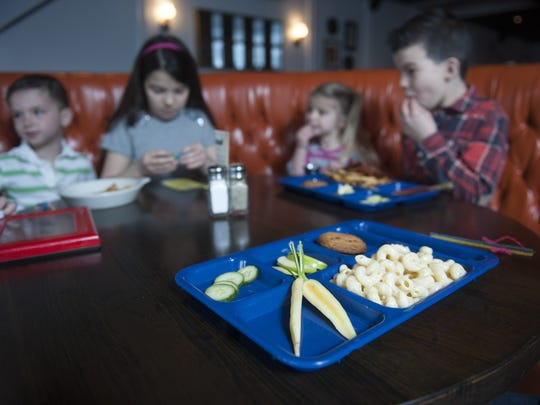 Plastic cafeteria trays are a big hit among the younger guests at Farm & Fisherman Tavern +