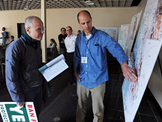 At Thursday's hearing, Ben Blom, field manager for the Bureau of Land Management Central Coast Field Office, explains proposed oil and gas leases to Brett Garrett of Santa Cruz.