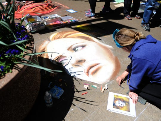 Jessi Queen of Atlanta works on her chalk drawing , at the 8th annual Dogwood Arts Chalk Walk in Market Square on Saturday, April 9, 2016. Queen often travels to chalk drawing competitions. (CAITIE MCMEKIN/NEWS SENTINEL)