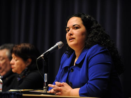 Immigration attorney Magnolia Zarraga speaks at a forum on the subject held on Monday, March 20th at Sherwood Hall in Salinas.