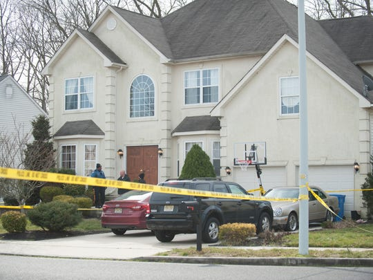 Police investigate a deadly shooting at a home on Downs Street in Clayton.