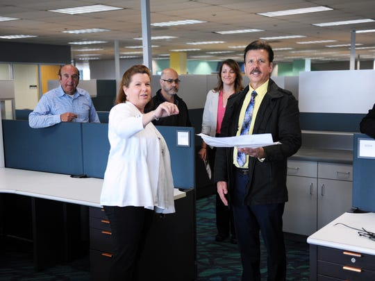 County employees look over their new office spaces at the debut on Thursday of 1441 Schilling Place in Salinas.